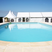 Wedding marquee across from a swimming pool